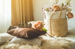 A lot of decorative cozy pillows and the inscription HOME royalty free stock photos