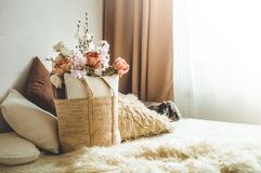 A lot of decorative cozy pillows and the inscription HOME stock photos