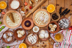 A lot of dessert on the wooden table. Georgian cuisine. Top view. Flat lay . Khinkali and Georgian dishes. A lot of food on the wooden table. Georgian cuisine Stock Photography