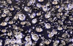 A lot of diamonds on a glossy reflective plane with blue tint, with depth of field stock photo