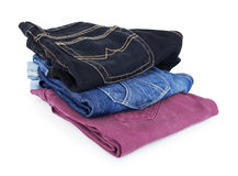 Lot of different blue jeans Stock Photography