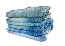 Lot of different blue jeans. Stock Photos