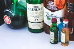 A lot of different bottles of whiskey royalty free stock photo