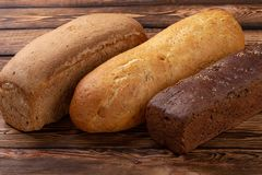 A Lot of different bread closeup. white, black, gray bread stock images