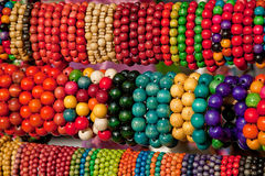A lot of different colored wooden beads Royalty Free Stock Photo
