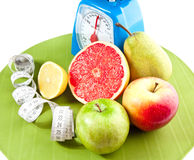 A lot of different fruits and scale Royalty Free Stock Photo