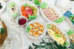 Lot of different meat snacks on rich luxurious catering table Royalty Free Stock Photography