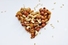 A lot of different nuts, poured in the form of a heart stock photography