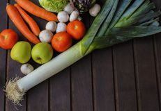 A lot different vegetables on the wooden surface royalty free stock images