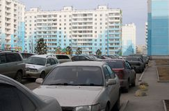 A lot of dirty cars crammed clogged yard no Parking problem no way through the chaos. A lot of dirty cars in the courtyard of a multi-storey building densely royalty free stock images