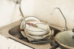 Lot of dirty dishes in the old kitchen Stock Images