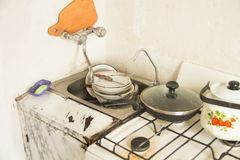 Lot of dirty dishes in the old kitchen Royalty Free Stock Image