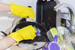A lot of dirty dishes in a sink waiting to be washed. A lot of dirty dishes in a sink waiting to be washed Stock Images