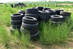 Discarded tires. A lot of discarded tires are next to the track royalty free stock photos