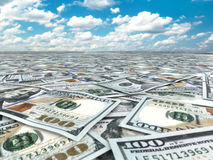 A lot of dollar banknotes and sky. Stock Photos