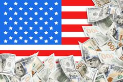 A lot of dollars and american flag background royalty free stock photo