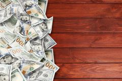 A lot of dollars on a wooden background stock photography
