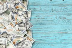 A lot of dollars on a wooden background stock photo