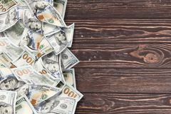A lot of dollars on a wooden background stock image
