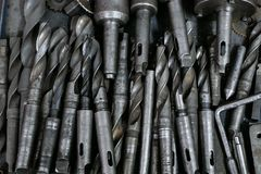 Lot of drill bits for metal lay in a pile royalty free stock photography