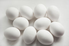 A lot of eggs as a background. Some eggs lie on a gray background Stock Photos