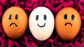 A lot of eggs with facial expressions Royalty Free Stock Photos