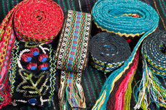 Lot of embroidered belts Stock Photos
