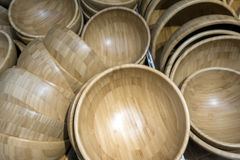 A lot empty bambo bowls in the store. This image is about a lot empty bamboo bowls in the store. Selective focus Stock Photos