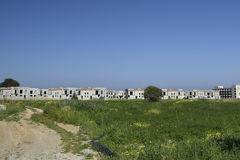 Lot of empty newly built houses in background and a blue sky Royalty Free Stock Images