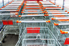 A lot of empty shopping carts for shopping in market Stock Images