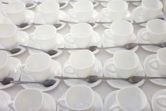 It is a lot of empty white net tea cups stock photo