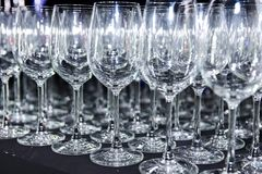 A lot of empty wine glasses on the bar royalty free stock photos