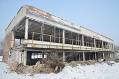The building of an abandoned river station. The photo was made standing on the ice of a frozen river. Russia. Siberia royalty free stock images