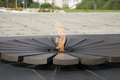 A lot and Eternal Flame - symbol of victory in World War II. Eternal Flame - symbol of victory in World War II Royalty Free Stock Images