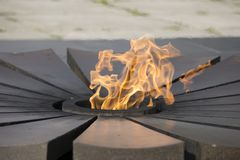 A lot and Eternal Flame - symbol of victory in World War II. Eternal Flame - symbol of victory in World War II Stock Images