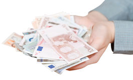 Lot of euro banknotes in cupped palms isolated Stock Photos