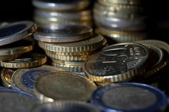 A lot of euro coins and cents on black. Background stock photography