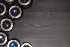 A lot of expensive photo lenses with colorful reflection as a background Royalty Free Stock Photos