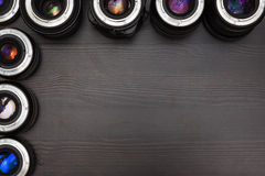 A lot of expensive photo lenses with colorful reflection as a background stock photos