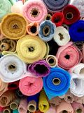Fabric roll in fabric store. A lot of Fabric roll in fabric store Stock Photography