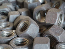 Lot of female screws. Background of lot silver ironwares screws closeup Royalty Free Stock Images