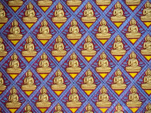 Lot of figure of buddha on concrete wall. A lot of figure of buddha on concrete wall in Penang thai's temple. The blue painted wall is decorated with gold Royalty Free Stock Image