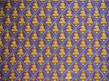 A lot of figure of buddha on concrete wall. In Penang thai's temple. The blue painted wall is decorated with gold pattern and a number of buddha figure Royalty Free Stock Photos