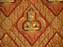 Lot of figure of deva on concrete wal. A lot of figure of deva on concrete wall in Penang thai's temple. The red painted wall is decorated with gold pattern and Stock Images