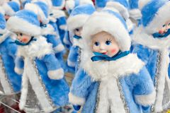 A lot of figurines of the Snow Maiden are on sale, on the counter in the store. Christmas decorations.  Stock Photo