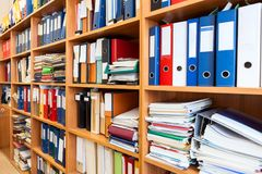A lot of files folder store in the office shelf: papers, documents and catalogs. A lot of files folder store in the office shelf: papers, documents, catalogs royalty free stock photos
