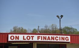 On Lot Financing on a Used Car Lot. A used car dealership offers on the lot in house bank financing on select low mileage pre-owned, certified and inspected stock photos