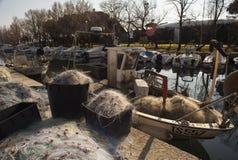 A lot of fishing net in the pier. Villaggio del Pescatore. Italy stock image