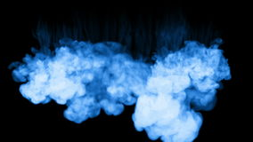 A lot of flows of fluorescent blue ink or smoke, isolated on black in slow motion. Blue gouache falls in water. Use for stock video