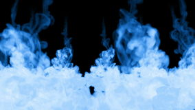 A lot of flows of fluorescent blue ink or smoke, isolated on black in slow motion. Blue paint reacts in water. Use for stock footage